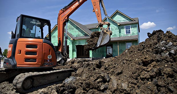 Home construction outlays, which account for almost 4% of gross domestic product, increased for a fifth straight month in November. In this May 15, 2019, photo, an excavator digs a trench outside a new home under construction at a Lennar Corp. development in Montgomery, Illinois. (Bloomberg file photo)