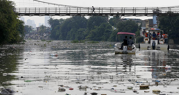 Waste management systems have failed to keep up with a growing population and robust consumption in the Philippines, which uses 48 million shopping bags and 164 million plastic sachets every day, according to the Global Alliance for Incinerator Alternatives. This Sept. 8, 2017, photo shows the Pasig River in San Juan, Philippines, clogged with plastics and waste. (AP file photo)