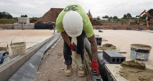 The U.K. market is growing rapidly, adding 15% more housing units in 2019, according to broker Savills Plc. A bricklayer works at a construction site Sept. 3, 2019, at Ashton Vale, near Bristol, U.K. (Bloomberg file photo)