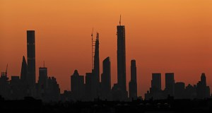 Part of the city skyline is seen at sunset from the grounds of the U.S. Open tennis tournament Friday, Aug. 30, 2019, in New York. (AP Photo/Adam Hunger)