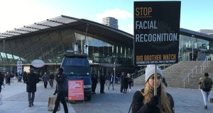 Rights campaigner Silkie Carlo demonstrates in front of a mobile police facial recognition facility outside a shopping centre in London Tuesday Feb. 11, 2020. (AP Photo/Kelvin Chan)