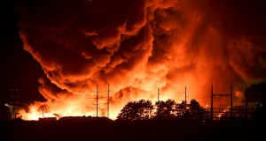 Flames and smoke tower into the sky at the Northern Metal Recycling plant Wednesday, Feb. 19, 2020, in Becker, Minn. (Dave Schwarz/St. Cloud Times via AP)