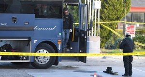This Feb. 3 photo shows investigators outside of a Greyhound bus after a passenger was killed on board in Lebec, California. Investigators say they don't yet know why a gunman opened fire on a Greyhound bus packed with passengers on a Southern California highway. (AP file photo)