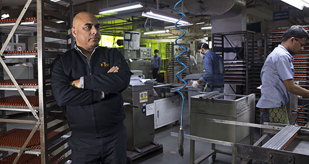 """In India, Vinod Sharma, managing director of Deki Electronics, calls it a """"panic situation."""" To compensate for the factory closures in China, the New Delhi-based maker of capacitors is leaning more heavily on South Korean suppliers. But their inventories may be quickly exhausted, because they too rely on plants in China for parts. (Bloomberg photo: Ruhani Kaur)"""