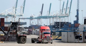 A truck leaves the docks Feb. 14 at PortMiami in Miami. The estimated 2.1% annual growth pace in the October-December quarter followed an identical gain in the third quarter, the Commerce Department reported Thursday. (AP Photo: Wilfredo Lee)