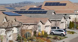 Solar panels have been installed on rooftops of a housing development in Folsom, California. (AP photo)