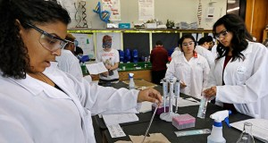 Research shows that students who take three or more courses in one career pathway earn more money in the decade after high school than similar students who did not take a group of related career and technical education courses. In this March 22, 2016, photo, Ananda Brooks, left, works on an experiment in Bio Tech class at Antioch High School in Antioch, California. (Bloomberg file photo)