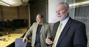Michael Fischer and William Bennett, lead a tour of the company's office space in Minneapolis. (File photo: Bill Klotz)