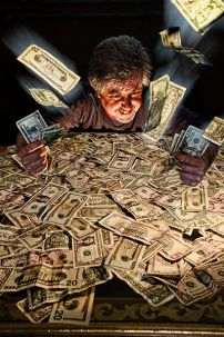 Image of a man wallowing in lots of cash