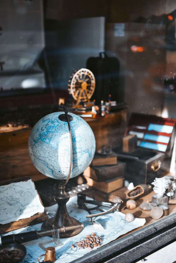 Globe on office table with many artifacts