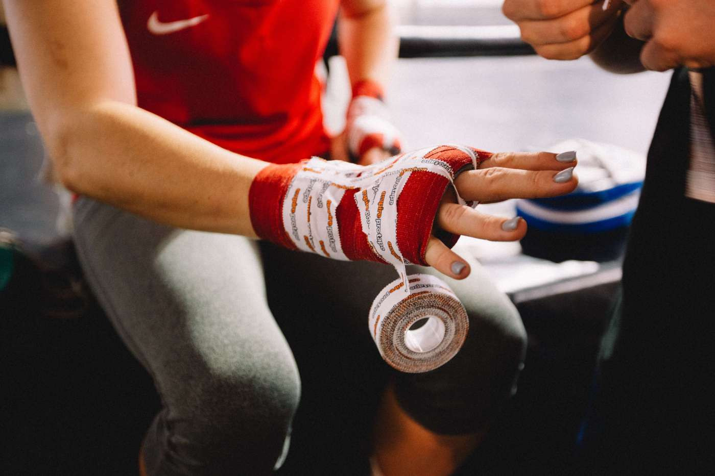 Grit - Woman Getting Hands Taped