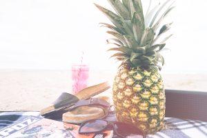 birkenstocks, sunglasses and a pineapple