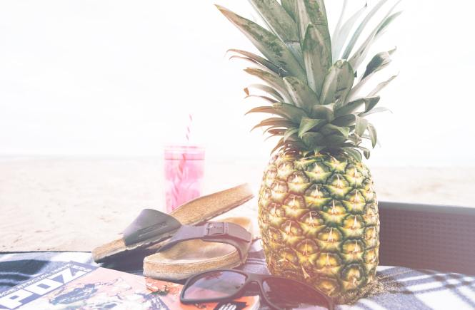 birkenstocks, sunglasses and a pineapple