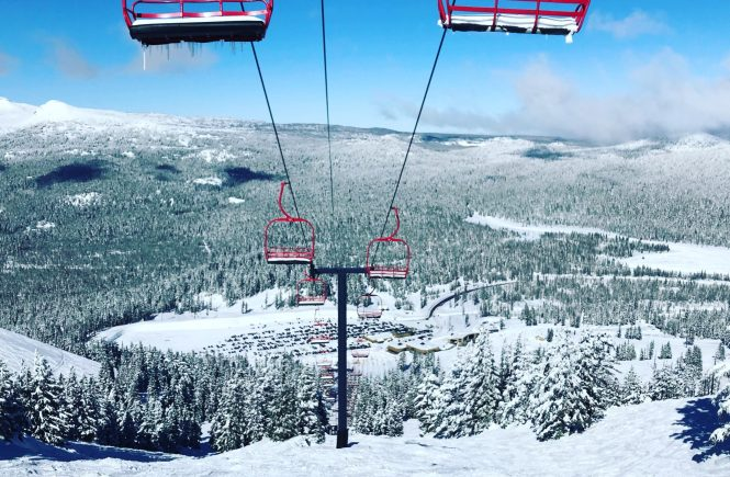 Red ski lift chairs and a snowy mountain