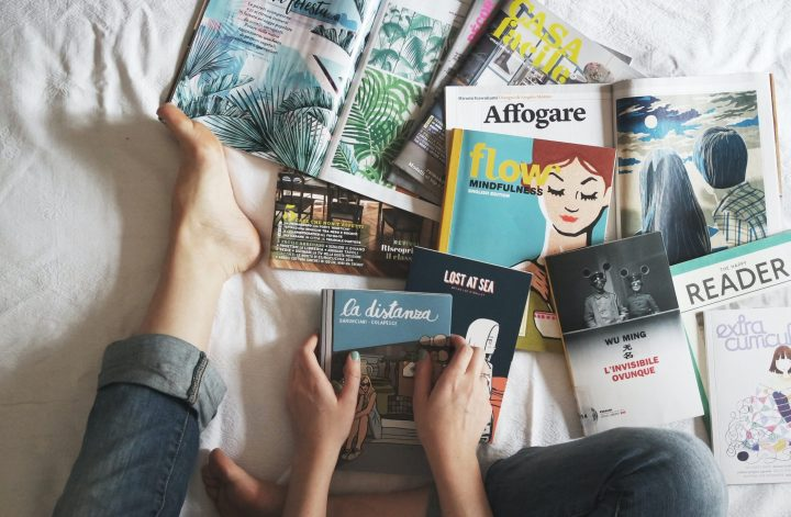 books strewn on bed