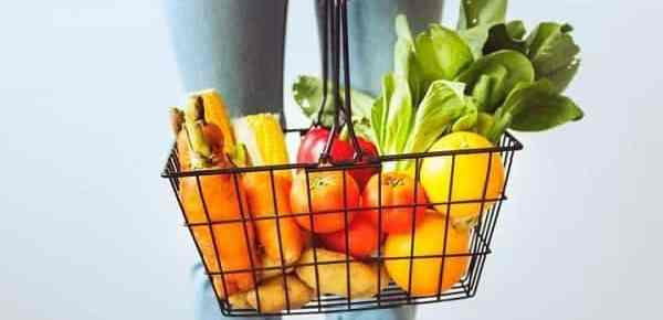 Aldi hiring tips photo with person holding basket with fruit and vegitables