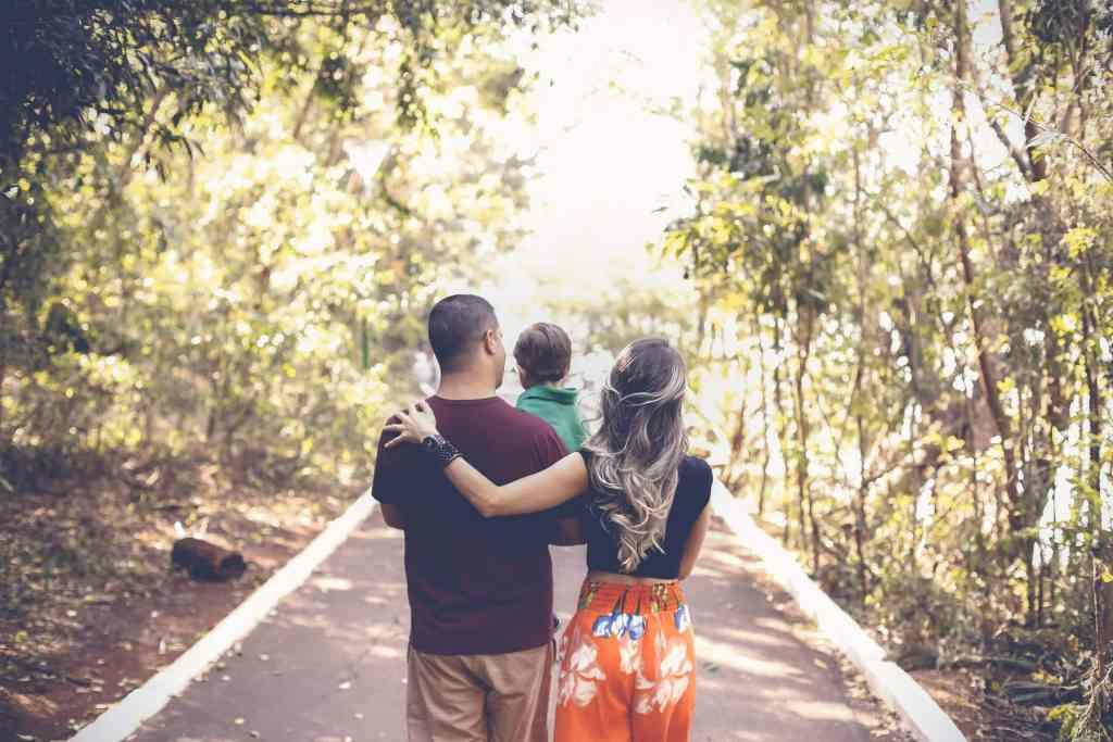 photo-of-family-walking-on-park-2880897-scaled