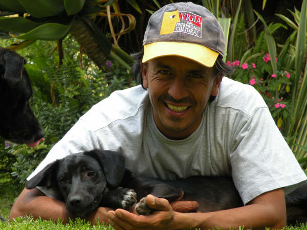 "Felipe ""older brother"" playing with his dogs"