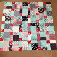 Daysail disappearing 9 patch baby quilt
