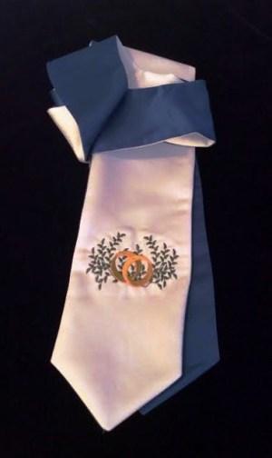 Custom embroidered wedding rings on white satin