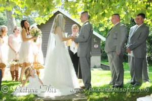 One of the most adorable flower girls ever - sitting on the Bride