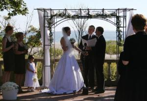 exchanging wedding rings at Harkness Memorial State Park, Waterford, CT