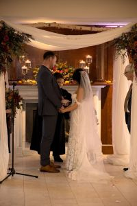 Rachel & David - Sharing a look during their ring ceremony in this beautiful Jewish wedding