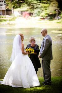 The back drop of a beautiful lake  and lakehouse that was owned by the groom