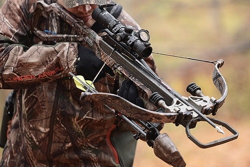 Man Holding Excalibur Crossbow 335