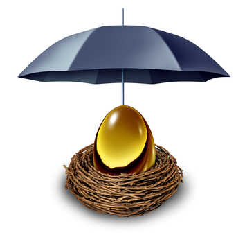 Financial security and retirement fund insurance symbol with a golden egg in a nest protected by a black umbrella against down turns in the economy and as a tax shelter on a white background.