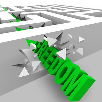 A green word Freedom crashes through the walls of a maze to break through the barriers of oppression
