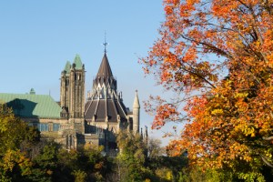 Part of the Ottawa Parliament buildings with a Canadian Maple Tree in the foreground