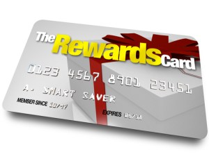 A credit card with the name The Rewards Card and a present shown on it illustrating the benefits, refunds and rebates you can earn by using a membership account