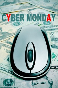 the sentence cyber monday and a computer mouse on a background full of dollar banknotes