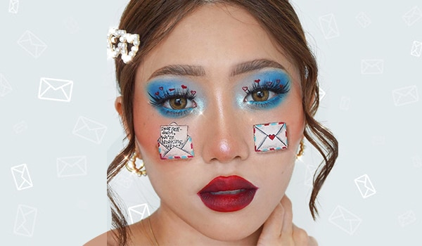 Mail-themed makeup look that talks about self-doubt