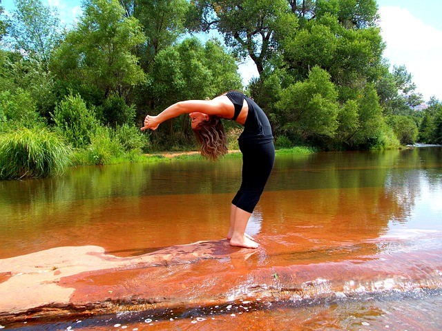 Yoga Salutations Over A Shallow River