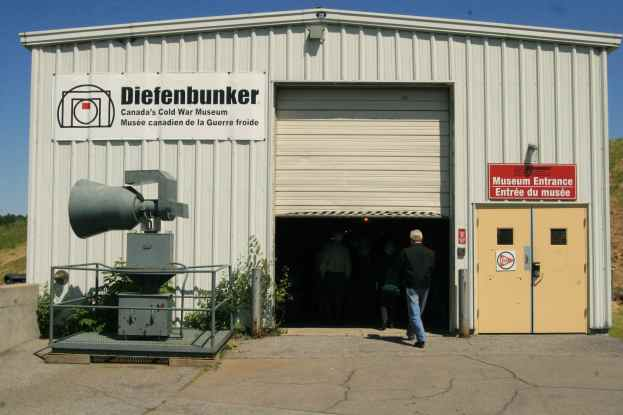 Diefenbunker: Canada's Cold War Museum. Here we see the entrance to the bunker facility. This enclosure would have been built after the original structure since it would not have withstood a nuclear blast. The air raid siren pictured outside the museum is on loan from the Canadian War Museum.