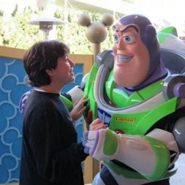 Andrew visiting with Buzz Lightyear. Moments like these are beautiful as families with special needs travel.