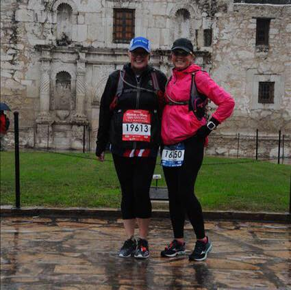 Two runners in the rain at Rock'n'Roll San Antonio Marathon just trying to control the controllables