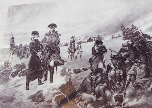 Washington inspects the troops during the winter encampment at Valley Forge in the American Revolution.