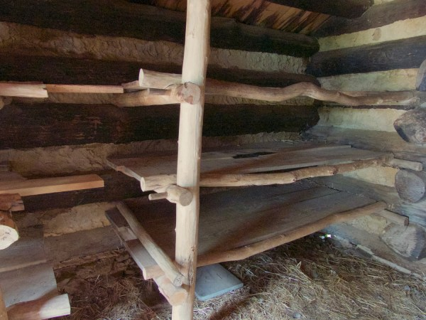 Crude wooden bunks in log cabin soldiers' huts at Valley Forge