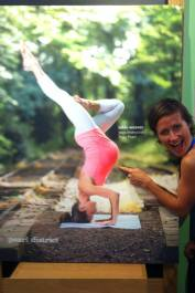 Nikki with poster of her doing a handstand in her third trimester. Y'know, like you do.