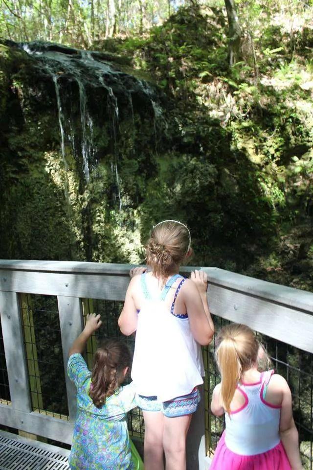 girls watching a Florida waterfall