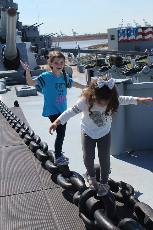 kids playing on the deck of the USS Alabama
