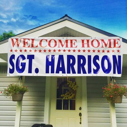 deployment welcome home banner that says welcome home Sgt. Harrison