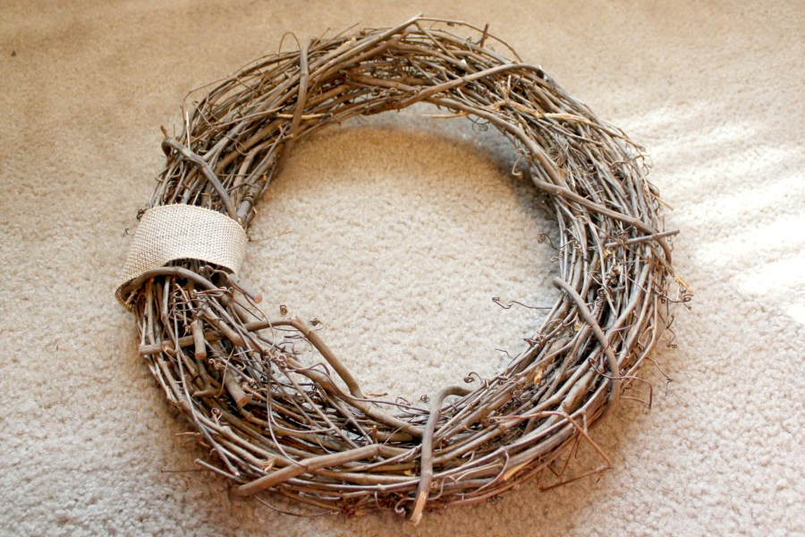 how to make a spring wreath - wrap a piece of ribbon around the grapevine wreath