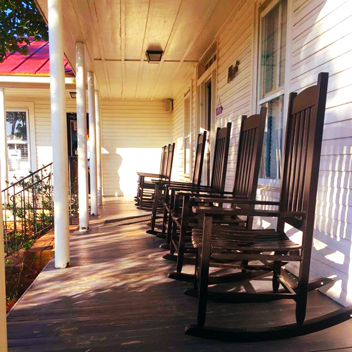 Homemade ice cream in a front porch rocking chair at Gillis Hill Farm is just what the doctor ordered!