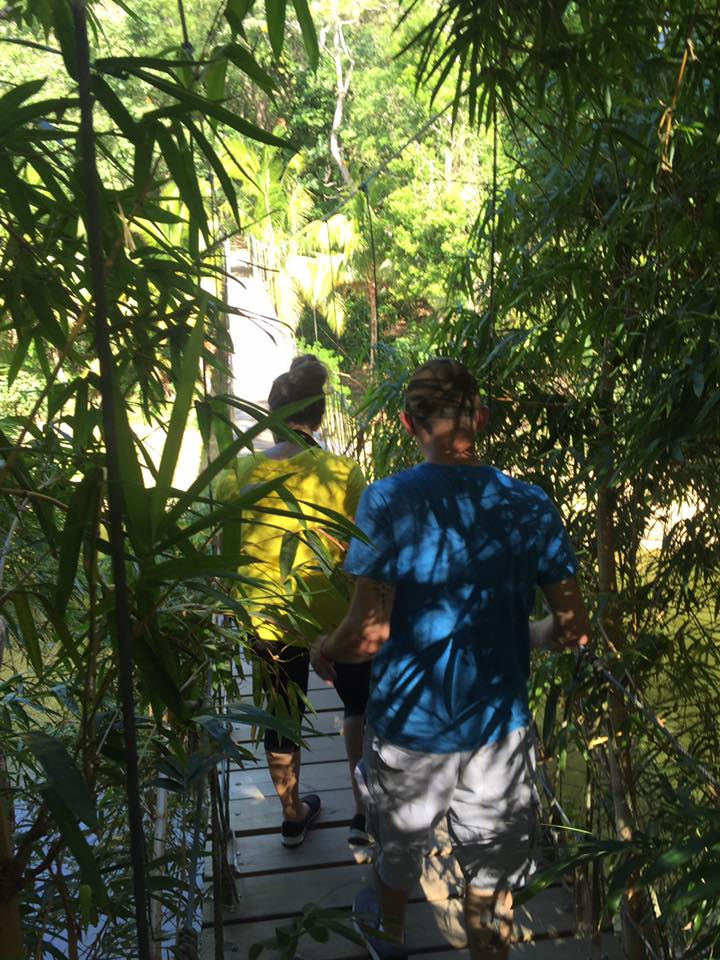 Walk across the Bridge of Pirate at Gumbalimba Park in Roatan, Honduras.
