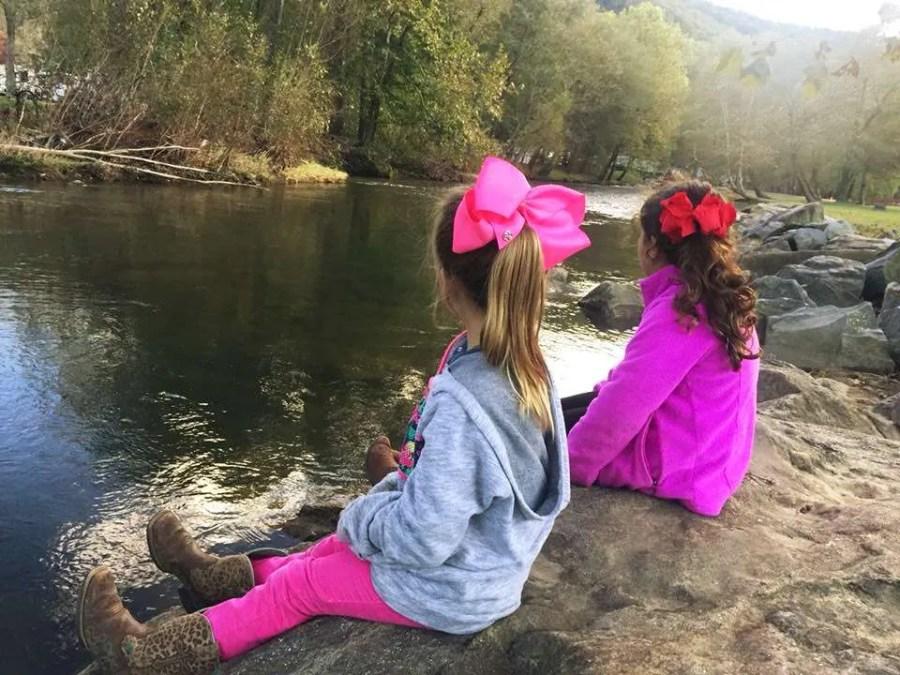 Asheville KOA East has campsites on the river.