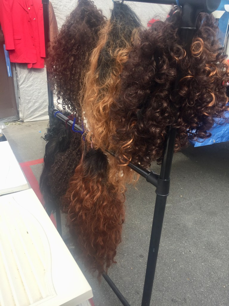 Wigs for sale at the flea market on Bragg Blvd. in Fayetteville, North Carolina.